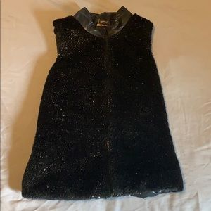 Girls puffy vest with fuzzy glitter front.